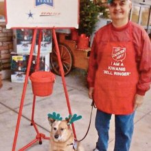 Art Masciere and his dog, Cody, ringing the Salvation Army bell.