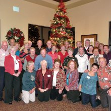 Members of the Tennis Club celebrating the holidays at their annual Christmas party.