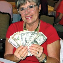 Maureen Lehrer is proudly displaying her winnings. Photo by Vicki Baker