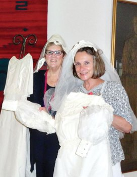 Marcia Wolf and Debbie Hall displaying their wedding attire