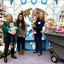Presentation of the toys by Dorothy Pointer, her grandson Crosby, Cook Children's Christmas Elf Dyani Merkley, Dorothy's daughter and granddaughter Keilee