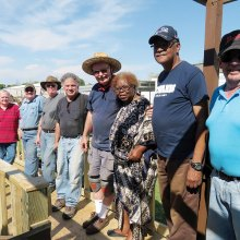 Kiwanis Club and happy homeowner showcasing the newly built ramp