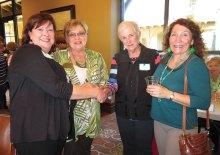 Sharon Foy, Paula Monroe and Judy Ondina welcoming guests