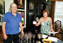 """Bill and Theresa Peoples toast """"kia ora,"""" be well and healthy!"""