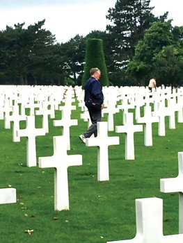 The Normandy American Cemetery includes 9,387 precisely aligned headstones of white Lasa marble Latin crosses and Stars of David.