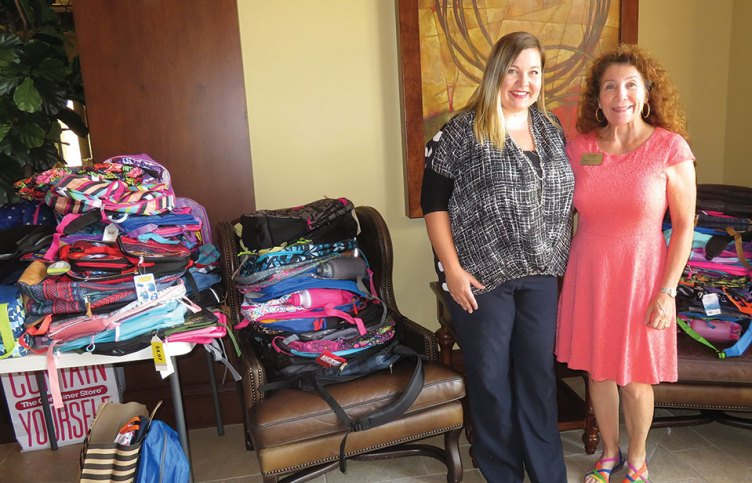 A sample of the donated backpacks and school supplies for Friends of the Family