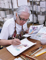 Linda Becker, painting clay watercolors.
