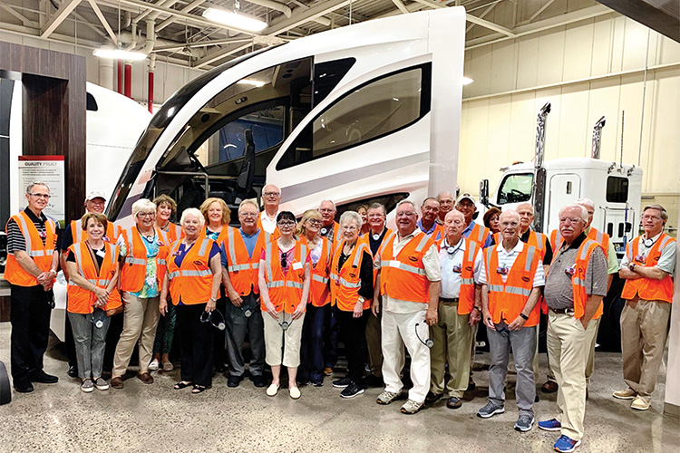 Robson Ranch residents enjoying and appreciating a tour of the Denton Peterbilt plant.