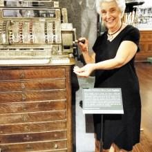 Bernadette Fideli is making change at the antique cash register.