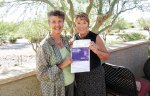Mary Beth Fisher presents to Terry Price, chairperson for the fourth annual Walk to End Alzheimer's, a check for $173.