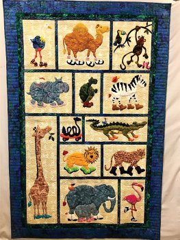 Wouldn't you love to win this quilt? The Material Girls will be raffling it off in November.