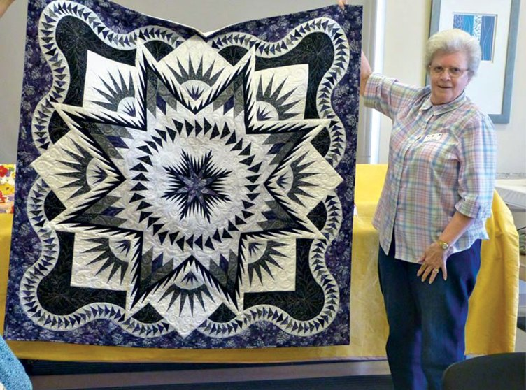Judy and her purple and white sparkle quilt