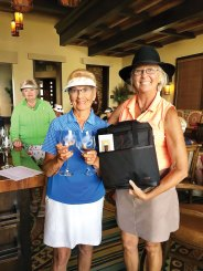 Club Champion 2019, Lorna Watts being presented with the trophy engraved wine glasses by Patty Bruchez, Tournament Chair.