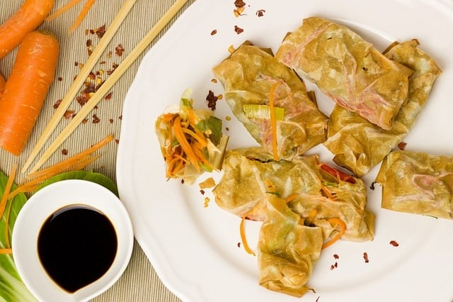 spring-rolls-on-a-plate-with-dark-liquid