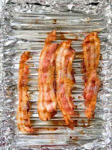 oven-baking-bacon-with-tin-folds