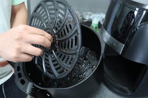 scrubbing-removable-air-fryer-drawer