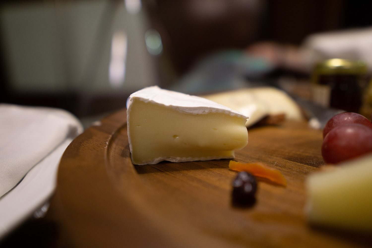 Brie cheese on cheeseboard