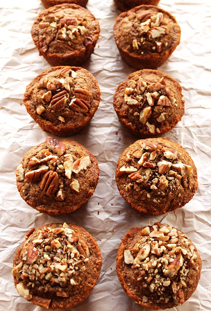 Spiced Carrot Muffins - A healthy muffin recipe. They are filled with carrots, raisins, and topped with pecans! Gluten free/Dairy Free! | robustrecipes.com