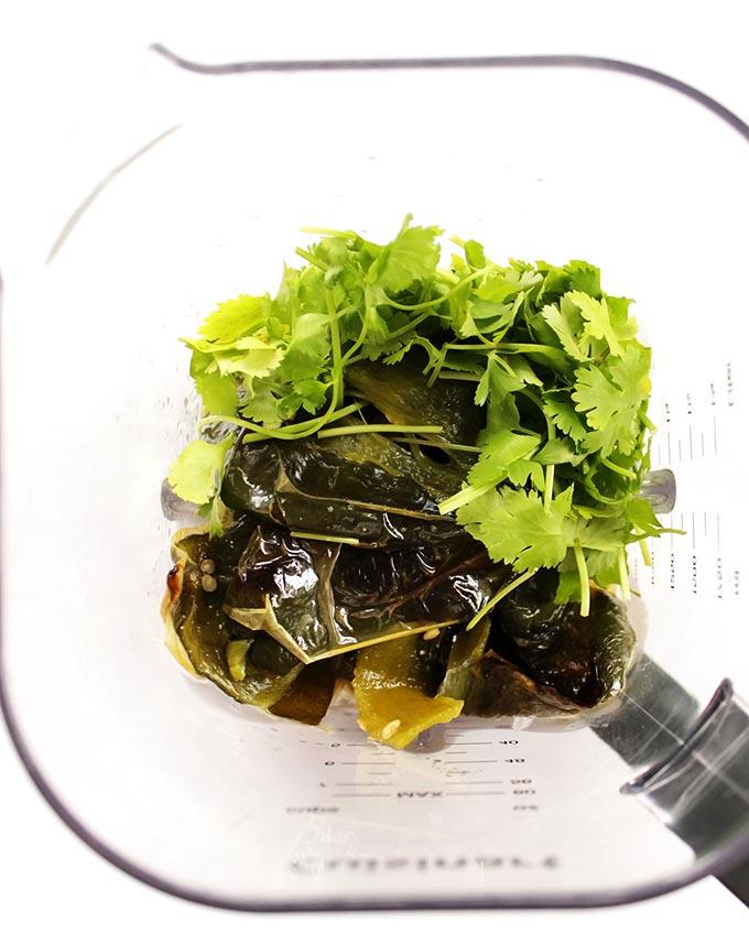 Roasted green Enchilada Sauce - garlic, shallots, poblano peppers, jalepenos, tomatillos, cilantro. | robustrecipes.com