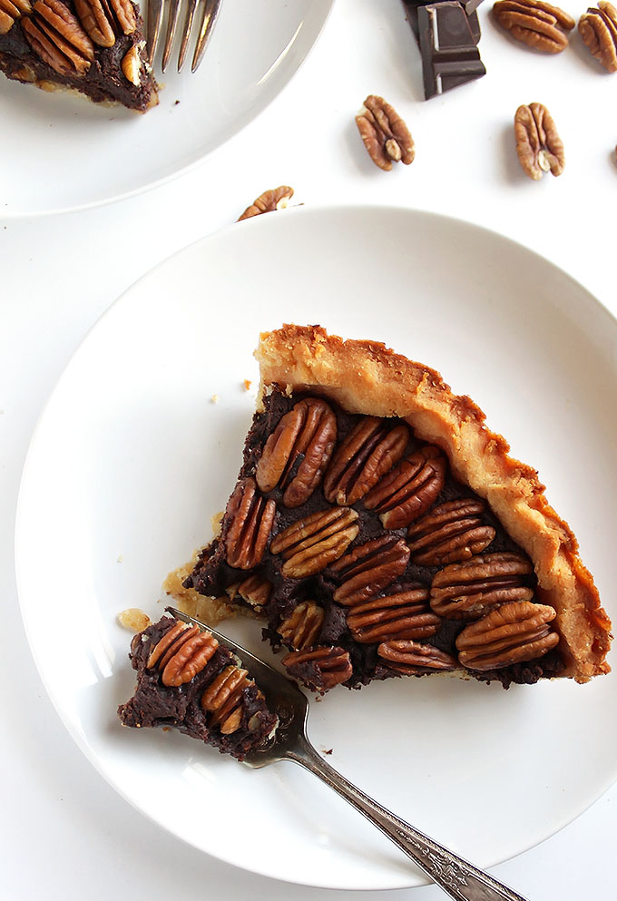 Gluten Free chocolate Pecan Pie - Rich, fudgey center with a doughy crust and crunchy pecans! This recipe doesn't contain corn syrup! It's super EASY to make and can be made days ahead of time. The perfect holiday dessert!   robustrecipes.com