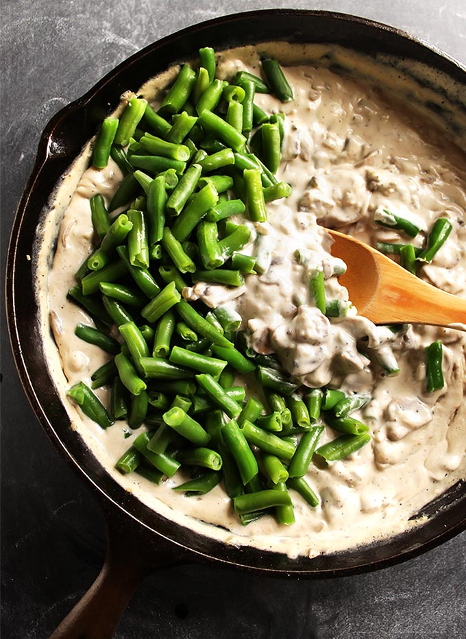 Gluten Free Green Bean Casserole - crunchy green beans in an super creamy dairy free sauce! No canned cream of mushrooms soup! Comes together in 45 minutes! Perfect recipe for you holiday menu! Dairy free/gluten free | robustrecipes.com