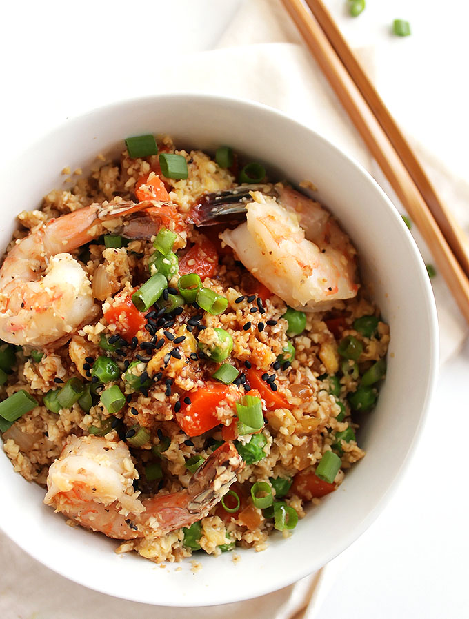 Cauliflower Fried Rice with Shrimp - The perfect weeknight meal! This recipe only takes 30 minutes to make and one pan! A healthier take on traditional fried rice. Packed with veggies! Gluten Free/ Dairy Free | robustrecipes.com