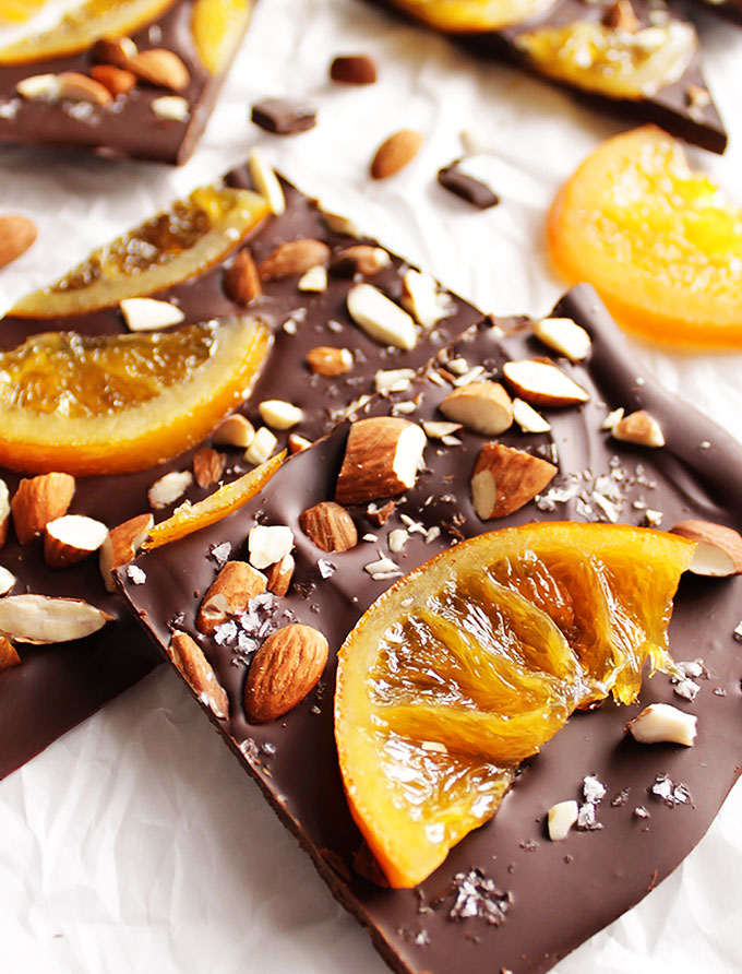 Dark Chocolate Bark with Candied Oranges - The perfect holiday treat and great for an edible gift! This recipe is so YUM! Dark chocolate topped with juicy candied oranges, almonds, and seas salt. Gluten Free | robustrecipes.com