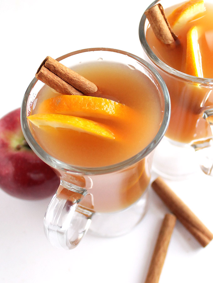 Slow Cooker Apple Cider + Boozy Bar - Delicious, easy fresh hot cider recipe made in the slow cooker! Best hot cider EVER! Make a hot apple cider boozy bar: set out an assortment of hard liquors, juices, cinnamon sticks, caramel sauce etc for guests to customize their own hot cider! Perfect for Halloween, Christmas, or New Year's Eve parties! So much fun! Gluten free/vegan | robustrecipes,com