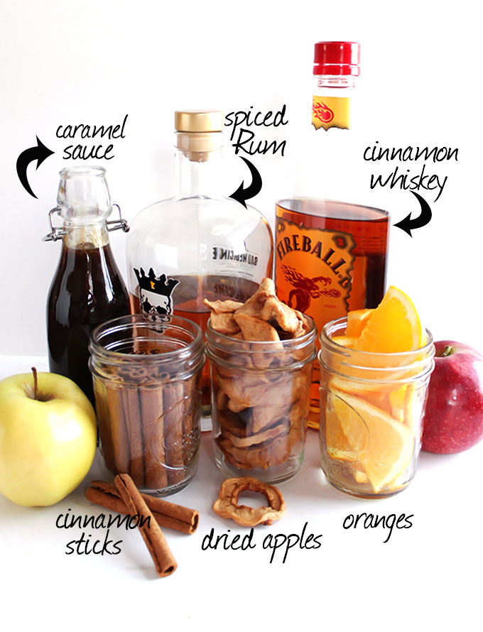 Slow Cooker Apple Cider + Boozy Bar - Perfect for Christmas, Halloween, or even New Year's Eve! Set out a variety of hard liquors, juices, caramel sauce, cinnamon sticks etc for you guests to customize their own glass of hot cider! The apple cider recipe is super EASY to make and super delicious! Gluten free/Vegan | robustrecipes.com