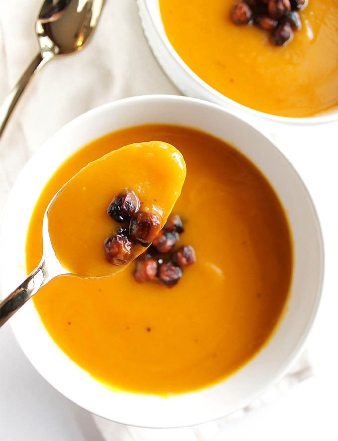 Slow Cooker Butternut Squash Soup - Smooth and creamy this soup is simple yet flavorful. It's topped with crispy chickpeas! This recipe makes a large batch, perfect for meal prep and freezes well. We LOVE this soup in the fall and winter! Vegan/Gluten Free | robustrecipes.com