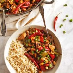 Healthy General Tso's Chicken - Sauteed chicken, onions, peppers, mushrooms, and peanuts in a sweet, salty, spicy sauce that is served over rice. This Asian inspired dish is perfect for weeknight dinners - only takes 30 minutes to make! Gluten Free/Dairy Free/Soy Free | robustrecipes.com