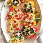 "35 Minute Pizza Stuffed Peppers - Healthy stuffed pizza peppers that come together in 35 minutes. You can use any of your favorite pizza toppings you prefer. This recipe is a fun way to get your ""pizza"" fix! Husband approved! Gluten free 