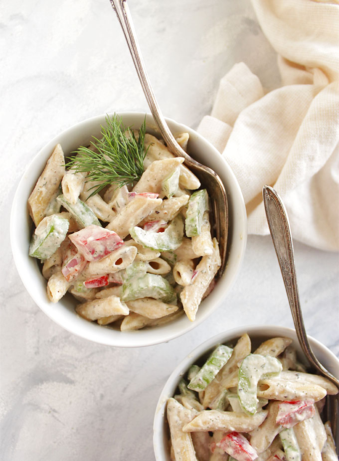 Mayo Free Pasta Salad - The sauce for this pasta salad is made using soaked cashews instead of mayonnaise. It's packed with crunchy veggies and a creamy, herb-y dressing. This recipe can be made up to 1 day ahead of time and only takes 30 minutes to make. It's the perfect recipe to bring to parties, pot lucks, picnics, and BBQs. Vegan/Gluten Free/ Dairy Free | robustrecipes.com