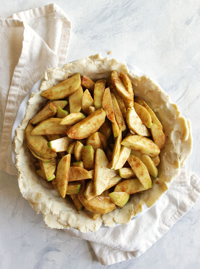 The perfect gluten free apple pie recipe! The apples are perfectly baked and the crust is flaky, buttery, and tender - no one will know it's gluten free. This pie makes a great Thanksgiving or Christmas dessert. So Yum! Also great for fall baking! | robustrecipes.com