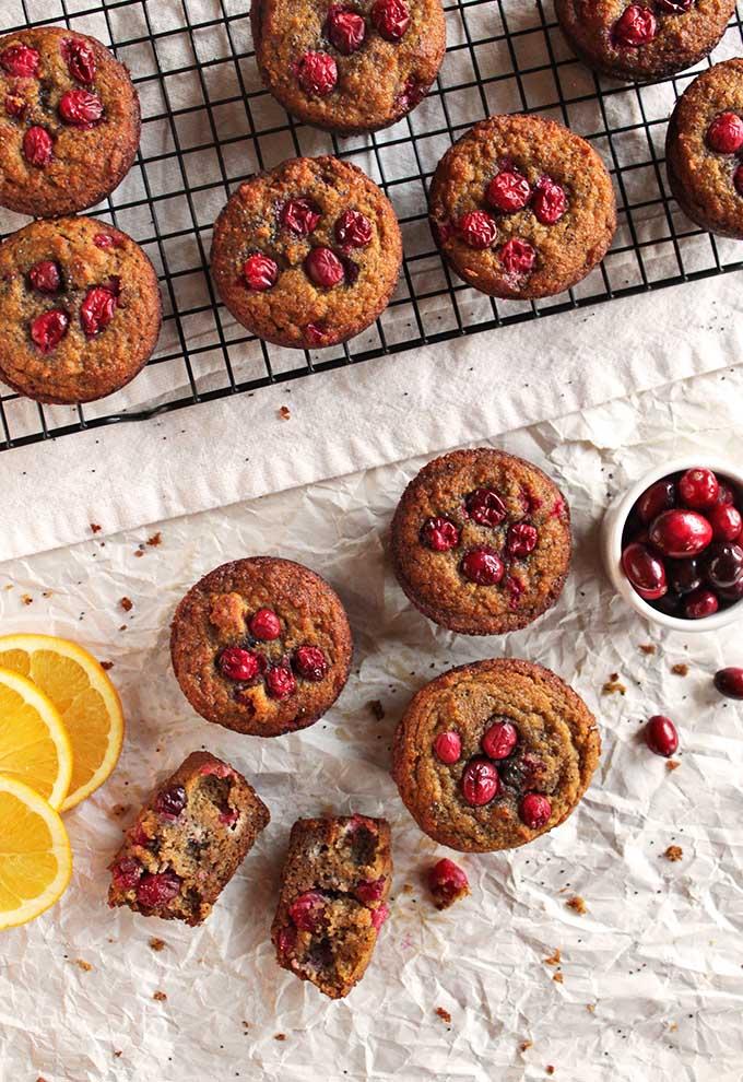 Gluten free cranberry orange muffins - the perfect balance of sweet and tart. They are packed with orange-y goodness, studded with juicy cranberries and crunchy poppy seeds. They are the perfect recipe for fall or any holiday - Thanksgiving or Christmas. | robustrecipes.com