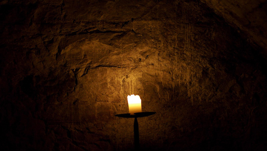 candle light in a dark cave