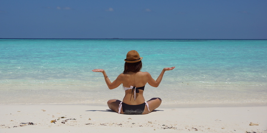 woman meditation on beach