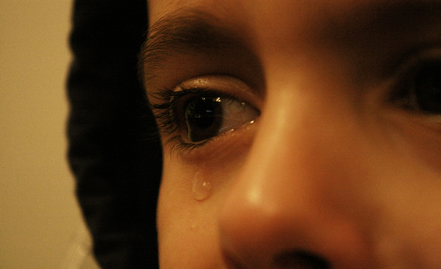 child with tear in eye