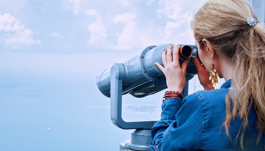 girl looking in binoculars