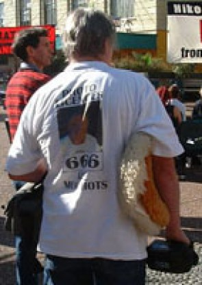 "His t-shirt reads ""Photo licences are 666 mugshots"". Managing to combine both a biblical theme and a splash of egotism in a fashion garment."