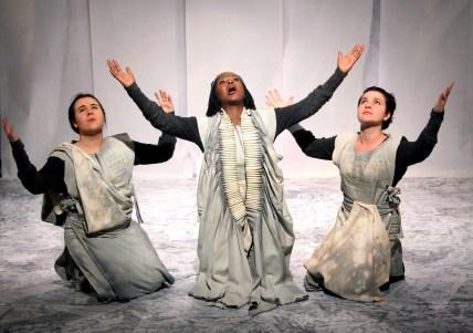 The chorus and Jocasta: Emma Tollman; Sizi Keke and Nicola Pilkington. Photograph by Ruphin Coudyzer.