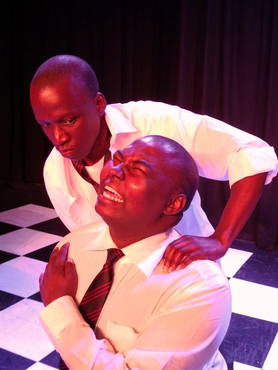"""""""I'll show you!"""" school bully Richie (Letshabang Moshime) tortures his victim Russell (Gamelihle Bovana). Photograph courtesy National Children's Theatre."""