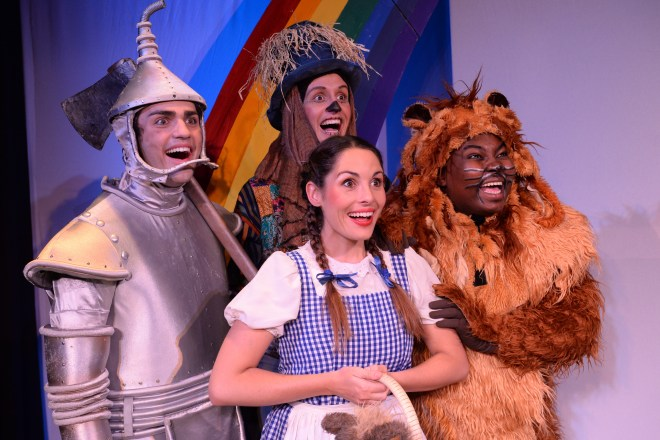 The Look of Enthusiasm says it all. Dorothy (Emma Hayden) centre, with her new found friends: the Tin Man who has no heart (Sean Louw); the  Scarecrow who has no brain (Phillip Schnetler); and the cowardly Lion (Gamelihle Bovana). Photograph courtesy National Children's Theatre.