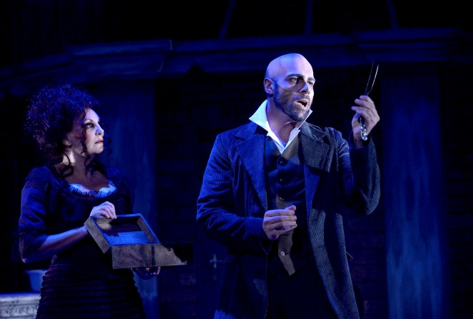 My friend: Sweeney Todd (Jonathan Roxmouth) adores his blade; Mrs Lovett (Charon Williams-Ros) looks on. Photograph by Val Adamson