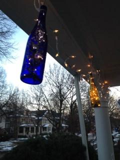 Wine bottle lights by Emily & Tim