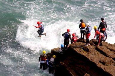Coasteering near St Davids and Solva, Pembrokeshire Coast National Park, South West Wales