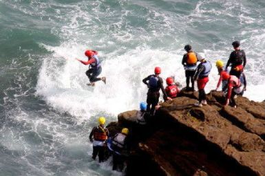 Coasteering near St Davids and Solva, Pembrokeshire Coast National Park, South West Wales