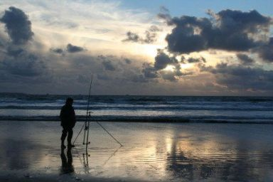 Fishing on Newgale Beach near St Davids and Solva, Pembrokeshire Coast National Park, South West Wales