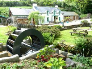 Mini wheel outside the eco friendly Granary holiday cottage at Roch Mill, near Solva, St Davids and Newgale, Pembrokeshire Coast National Park, South West Wales