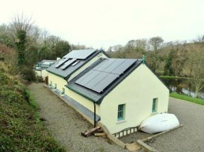 Solar PV panels on garage at Roch Mill, near Solva, St Davids and Newgale, Pembrokeshire Coast National Park, South West Wales